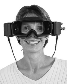 Smiling woman wearing vestibular testing goggles