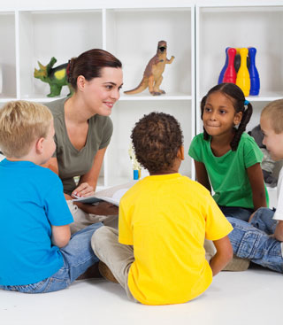 Four children sit in a circle with a Speech-Language Pathologist