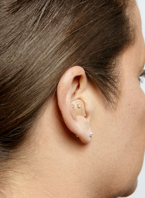 An ITE hearing aid on a woman's ear