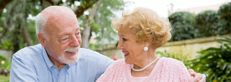 An elderly couple in conversation in a park